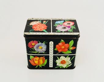 A Mid Century Floral Tin.