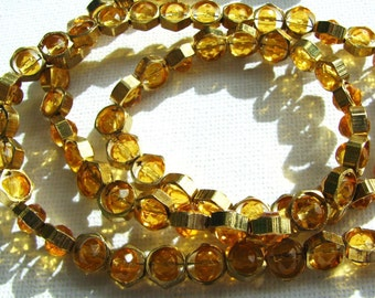 From the Hive.  Honey coloured Czech fire polished beads in brass honeycomb beads. Necklace