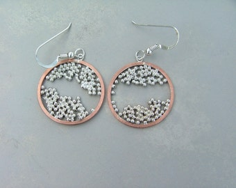 Earrings: Copper and Sterling Silver Earrings Round Spore Design.