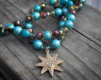 Shimmery turquoise and gold toned beaded necklace with matching earrings and a memory wire bracelet!!!