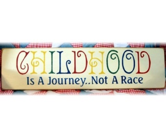 CHILDHOOD is a journey not a race primitive wood sign