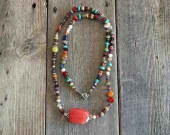 Semi precious stone necklace. 37mm X 27mm watermelon quartz w/freshwater pearls, turquoise, carnelian, swarovski crystal and Sterling beads