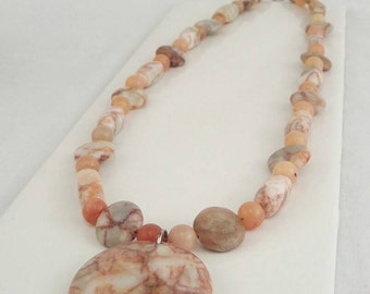 Peach necklace with pendant