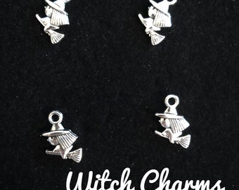 4 Witch charms antique silver tone, witch riding broom