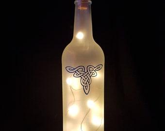 Frosted bottle light with Celtic design