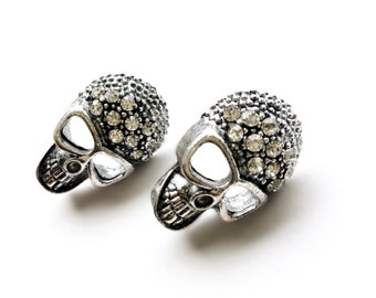 Skull & Rhinestone Studs. Available in Antiqued Brass or Antiqued Silver. Fast FREE Shipping For Domestic Orders.