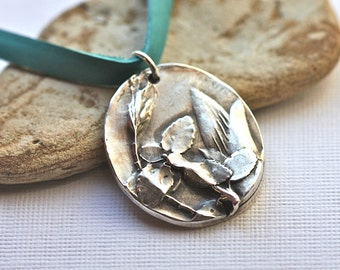 Sterling Botanical necklace on leather lace with a sterling clasp