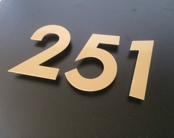 Gold House Numbers set with mount holderst o stay on a distance from the wall