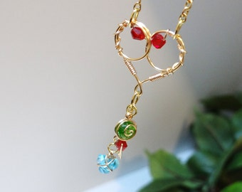 Golden Heart Piece with Hanging Spiritual Stones and Triforce Back