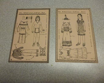 2 paperdolls: an Am. Indian girl + an American Indian boy. Mint. Postcard format. Navoho dress, woodland shirt. Pub. by Kay Stamps