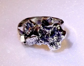 Forged sterling silver ring with fused reticulated design.  Vintage 1964 creation by Melinda Mead.  Size 7.