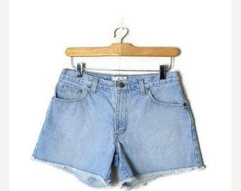 ON SALE Vintage Light Blue Denim cut off Shorts from 90's*