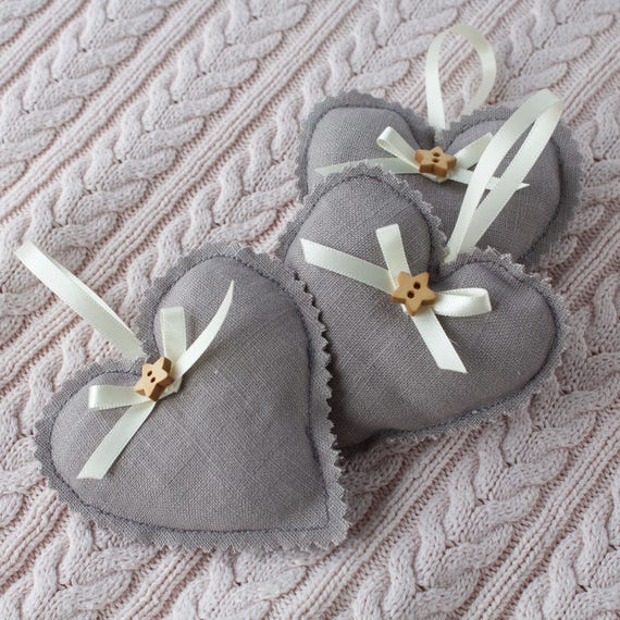 Three little linen hanging hearts.