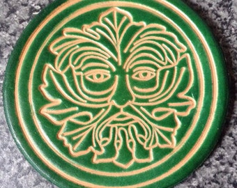 Handmade Leather Coaster, Green Man design by Cordwain Higgler. Kelly Green or Cordovan Brown