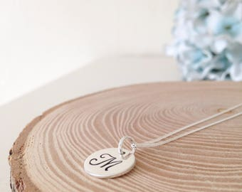 A medium sterling silver disc necklace on a sterling silver chain
