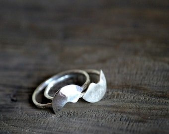 Two complementary Sterling silver rings