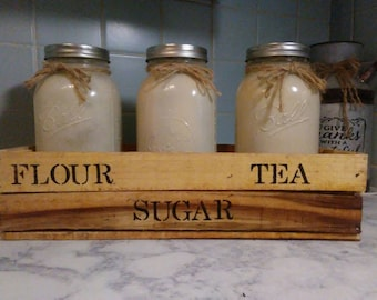 Set of three quart size mason jars with a beautiful wooden box made out of reclaimed wood.