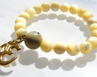 Beige Natural Agate Gemstone beads with OM gold filled charm stretch bracelet.