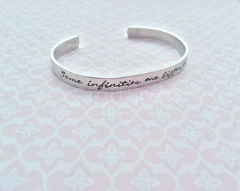 Some infinities are bigger than others aluminium cuff with cute infinity symbols. Hand stamped