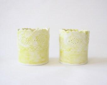 Set of 2 yellow porcelain tealight holders