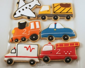 12 cookies in two designs: Plane, Police car, Fire truck, Train, Dump truck, Ambulance - handmade & iced