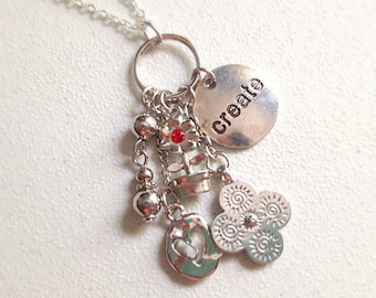 Create Medallion Necklace. Word Jewelry. Message Necklace. Long Silver Chain. Under 10. Creativity. Artist. Inspirational. Flower. Heart.
