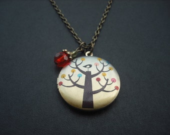 25% off - bird on a tree locket necklace
