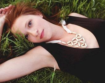 ivory rice wood triangle daisy wood necklace