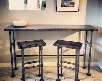 Live edge dining table set with (2) stools.