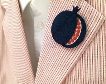Blue pomegranate boutonniere for gentleman attire, original lapel pin for dapper man.