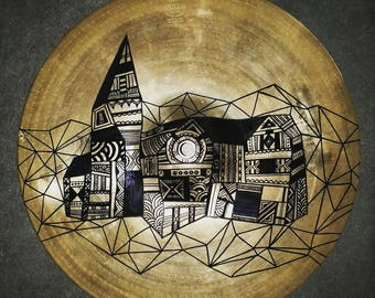 Art on cymbal - Abstract line drawing of a town on a used Zildjian cymbal