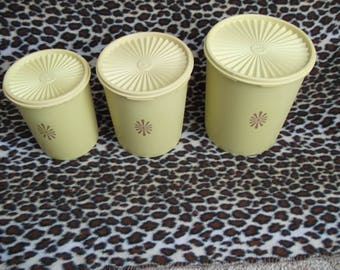 Vintage tupperware containers, plastic food storage, yellow set of three canisters,