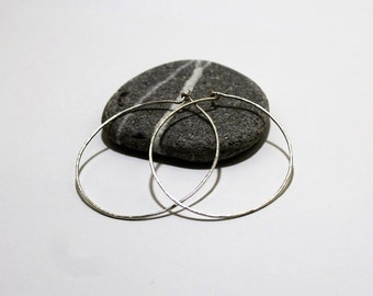 Skinny Oval Sterling Silver Hoop Earrings 5.5x5cm With Hammered Texture Made In The UK by Lady C Jewellery