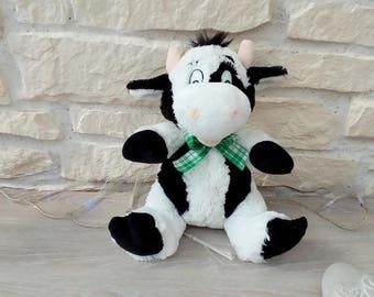 Cuddly plush representing a cow
