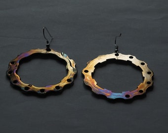 Rainbow effect earrings made from bicycle sprockets