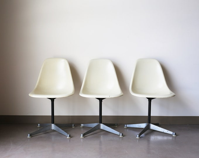 Featured listing image: Sold *** Set of 3 Herman Miller by Eames White Fiberglass Shell chairs on contract / swivel base