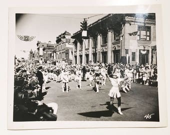 vintage black and white photo of parade with majorettes