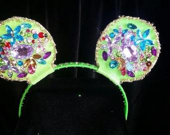Multi-colored rhinestone covered mouse ears