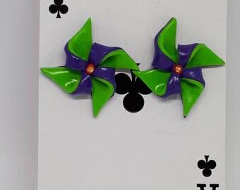 Green and purple pin wheel stud earrings.