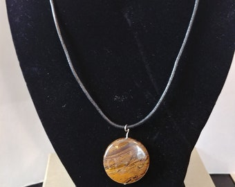 Tigers eye pendant on leather cord necklace