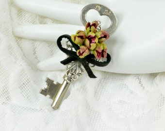 Red Flower Key Boutonniere