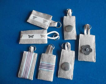 Decorative linen fabric or metal keychain