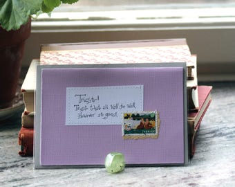 Trust! Trust that all will be well, however it goes Pale lilac card with handwritten quote and lake side postal stamp