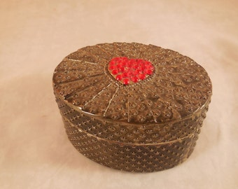 Vintage silver trinket box with a red heart on the top.