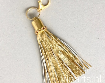 Leather tassel bag charm in gold metallic leather and gold tone chain decoration leather. Gold tassel purse charm