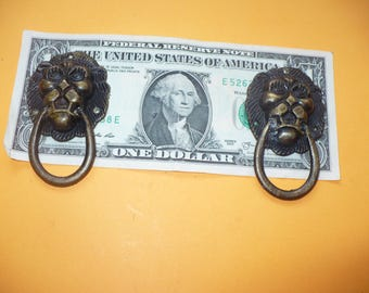 Two Small Vintage Lion Face Drawer Pulls
