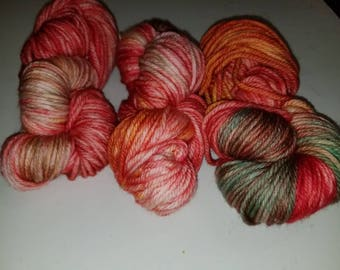 "Terri, a hand-dyed superwash merino wool bulky weight yarn. 137yds/100gms/hank.  3-3.75sts=1"" on #10-11 needles."