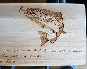 Cutting board with pattern: trout and quote