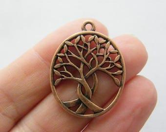 4 Tree pendants antique copper tone CC8