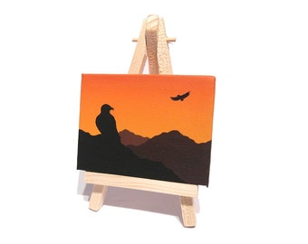 Eagles at Sunset Miniature Art - small original mountain landscape, silhouette of birds of prey against orange sky. Mini canvas with easel
